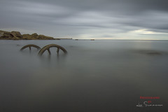 Braving the cold. (Lee Summerson) Tags: uk longexposure england seascape clouds canon landscape whitewater europe wheels stormy stormyweather seaham countydurham thenorthsea northeastengland durhamuk ndx400 tidalflow tokina1116mm canonuk seahamwheels