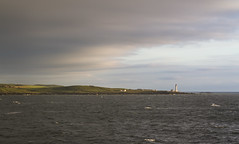 Out at sea (A blond-Tess) Tags: uk light sea lighthouse clouds canon t evening scotland cloudy britain scottish hills 7d cloudysky irishsea canonphotography outdoorphotography sigma1750mmf28 tessaxelsson