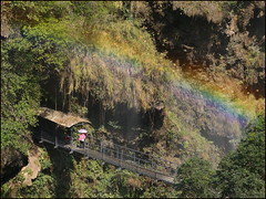 Under the Rainbow (Christian Lagat) Tags: china woman umbrella waterfall rainbow femme  guizhou suspensionbridge chine xingyi arcenciel parapluie chutedeau ombrelle pontsuspendu   sonynex6 gorgesdumalinghe malingrivergorge