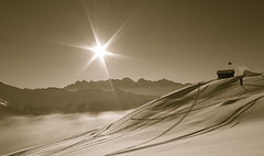 A flight over the Alps. (clicheforu) Tags: bw cloud sun mountain snow alps love sol nature sport rock montagne alpes canon landscape switzerland soleil jump freestyle montana bc view ride suisse swiss nieve nb relief hut snowboard passion backcountry neige minimalism cabane kicker flickraward clicheforu christianpetit svirezza aflightoverthealps anthonyduchateau