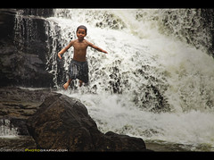 The weekend is here! Lets jump for joy! Tad Lo, Laos; Southeast Asia (Sam Antonio Photography) Tags: shirtless people cliff mountain motion sports nature water weather childhood rock vertical horizontal river outdoors photography waterfall jump asia stream southeastasia day child looking action tranquility innocence flowing laos cultures idyllic lao oneperson frontview travelphotography southernlaos flowingwater champasak traveldestinations colorimage beautyinnature laoboy nonurbanscene tadlo theworldthroughmyeyes childrenonly oneboyonly laopeoplesdemocraticrepublic tatlo bolavenplateau focusonforeground laopdr elementaryage boyjumping salavanprovince champasakprovince canoneos5dmarkii motorbikelaos laochildren bolavanplateau travelfishlaos samantoniocom bansaenvang paksedaytrip saravanhprovince tadhangwaterfall
