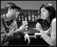 Nightcap (alton.tw) Tags: portrait people blackandwhite bw woman man male love hat sex female accord asian island restaurant nikon couple asia julie counter wine bottles yo profile taiwan meeting cap drinks seduction formosa  alton var altonthompson taiwanese connection nightcap attraction 2010 rapport banciao banqiao nightspot  newtaipei taiwanphotographers  newtaipeicity altonsimges