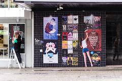 Art Imitates Life (Moe W) Tags: street woman canada man reflection girl vancouver bc legs tshirt brush clean sidewalk posters roller barefeet shorts ladder mauricewoodworth