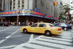 this is NY.... (Suzanne's stream) Tags: newyork motion car us taxi cap radiocitymusichall