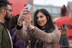 Selfie (Streetphotography by Joost Smulders) Tags: city portrait urban holland color colour girl beautiful amsterdam museumplein photo foto candid young nederland streetphotography tourist mooi portret vrouw stad jong mensen selfie kleur toerist straatfotografie
