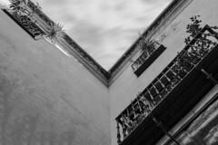 - V Look UP X. - (Mr. LookUP II M.K.Z.P. II) Tags: street urban bw building architecture clouds canon blackwhite movement spain balcony streetphotography wideangle lookup toledo 1740mm longtimeexposure blackandwithe vlookup urbanexplore 5dmarkiii