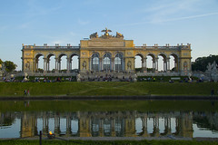 Gloriette at sundown (Princess Ruto) Tags: schnbrunn vienna wien blue sunset sky reflection building green pool architecture gold dusk lawn arches palace column gloriette