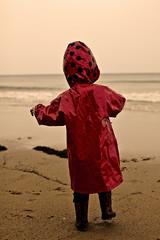 Beach life (jezselten) Tags: ocean baby holiday cold cute love beach water girl proud female sand mine waves child power boots little walk sandy small footprints australia victoria lucky ladybug hood greatoceanroad raincoat lorne stumble