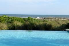Kiawah (palm_goodness) Tags: ocean blue beach pool grass fence sand waves infinity dune atlanticocean shimmering endless