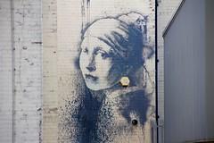 Banksy artwork (jeannie debs) Tags: street art girl bristol drum earring banksy ear pearl burst