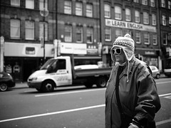"London Black and White Street Photography - ""The Great Londoners"" (Nicholas Goodden) Tags: people wool monochrome hat sunglasses camden candid voigtlander streetphotography olympus oldlady shotfromthehip manualfocus camdentown blackandwhitephotography urbanphotography londoners peopleonthestreets manuallens learnenglish blackandwhitestreetphotography londonphotography microfourthirds omdem1"