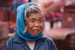 Planetary blue~ Yunnan (~mimo~) Tags: china street blue portrait people woman hat teeth streetphotography knit yunnan ethnicminority honghe