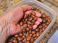 Unsweetened Chocolate Goodies! (Jo-Back To The 80's Again!) Tags: kitchen mine hand counter chocolate peanuts raisins container odc smallluxury