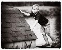 Climb (Oliver Leveritt) Tags: nikond610 afsvrzoomnikkor70300mmf4556gifed oliverleverittphotography blackandwhite monochrome sepia platinum boy child play climb roof