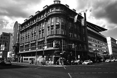 Berlin Street Scene (ericgrhs) Tags: street city urban bw building berlin clouds wolken strase