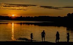 Family Fun (Doug Wallick) Tags: park family sunset lake beach minnesota silhouette swim fun bush warm bloomington splash hyland recreatiom