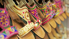 Which one to pick?! They all looked so beautiful :) (| Haroon |) Tags: summer art festival shoes colorful bokeh handmade sandals unique eid culture lovely decisions chappal khairi handembroidered summerwear