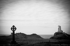 The cross & the lighthouse (Lee~Harris) Tags: uk sea blackandwhite lighthouse monochrome beautiful landscape mono coast cross outdoor anglesey