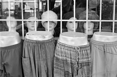 Skirts and Hats (geowelch) Tags: toronto blackwhite chinatown 35mmfilm pentaxmx c41 urbanfragments xp2400 pentaxm50mmf17 plustekopticfilm7400