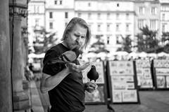 Krakw Pigeon Feeder (Foto John) Tags: leica people blackandwhite man monochrome blackwhite feeding pigeons streetphotography poland polska krakw cracow leicam leicam240 leicamtyp240 blackandwhitethatsright summicronm50mm2iv