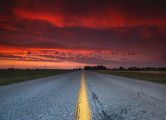 Yellow Line Sunset (Cale Best Photography) Tags: road ca sunset red summer sky ontario canada color colour weather clouds rural landscape pavement essexcounty sony wide dramatic sigma wideangle transportation windsor drama amherstburg yellowline middleoftheroad sideroad twolane calebest