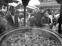Sensoji IX (Douguerreotype) Tags: city people urban blackandwhite bw monochrome japan temple mono tokyo shrine candid buddhist crowd incense