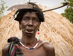 Mursi Woman (Rod Waddington) Tags: africa african afrika afrique ethiopia ethiopian ethnic etiopia ethiopie etiopian thiopien omovalley mursi tribe traditional tribal woman female outdoor portrait people feather beads costume native mago national park