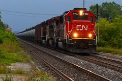 Overcast day (Michael Berry Railfan) Tags: cn train tank quebec montreal ge bnsf dorval dash8 generalelectric canadiannational oakway emd gmd atsf tankcars sd60 sd70m2 unittrain dash840cw cn700 oiltrain crudeoiltrain cnu700 cn2098 cn8919 cn5403