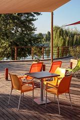 Kopaszi gát (dam) - orange chairs (Romeodesign) Tags: orange table hungary chairs dam budapest duna peninsula 550d gát kopaszi