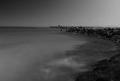 around the bend (Laws Photography | www.lawsphotography.com) Tags: longexposure blackandwhite bw water canon pier daylight rocks smooth le nd400 110sec