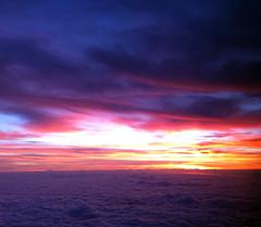 2013_12_20_lax-iah-iad_42c (dsearls) Tags: pink blue sky orange yellow clouds sunrise flying texas purple aviation united flight violet aerial ual stratus iah cirrus unitedairlines windowseat windowshot altostratus 20131220 laxiahiad