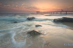 Shining! - Fintas Beach - Kuwait (AlkhashabNawaf) Tags: sea orange beach water sunrise pier nikon rocks waves lee kuwait nikkor filters d800 nawaf 1635 fintas شاطئ بحر شروق جسر صخر اسكله نيكون نواف الفنطاس اسكلة الخشاب alkhashab دي٨٠٠