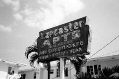 Old Neon Sign (Phillip Pessar) Tags: camera bw white black film beach sign analog us store neon florida zoom kodak miami district infinity tx trix north places olympus x historic national thrift shore 400 register tri 70