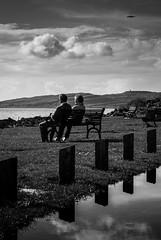 In A Reflective Mood - 2 (DrJekyll UK) Tags: reflection togetherness coast coastal together reflective enjoyingtheview reflectedsky portencross scottishcoast coupleonabench ayrshirecoast