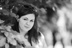 Her (brenkee) Tags: portrait white black girl monochrome smile sunglasses canon happy bokeh f2 eos3 135mm bokehlicious