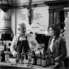 Holy spirits (John Riper) Tags: street people bw woman white man black church netherlands monochrome canon john square photography mono bottles zwartwit candid interior stall spirits event crucifix l gin cultural schiedam 6d 24105 genever jenever straatfotografie gincity riper johnriper jeneverfestival