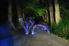 Light Painting (jna.rose) Tags: road blue trees light red abstract tree green leaves night dark painting spiral lights design woods nikon colorful long exposure outdoor spirals awesome creepy nighttime slowshutter swirl rgb wooded lightwriting d80