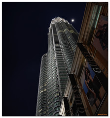 Petronas Towers (Manoj D'Souza) Tags: park glass fashion guess steel petronas towers skybridge spire deck walkway malaysia twintowers dsouza klcc lumpur petronastowers parklands highest tallest kula manoj bilboards kulalumpur manojphotography manojdsouza pellicesar dsouzaphotography