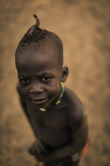 Young Himba Boy (Baron Reznik) Tags: africa boy portrait look vertical hair kid child african traditional tribal afrika tribe ochre ethnic namibia everydaylife braid kaokoveld 頭髮 afrique plait 非洲 kaokoland colorimage kunene indigenouspeoples 어린이 소년 아프리카 원주민 ovahimba canon50mmf12l 털 himbapeople omuhimba 纳米比亚 부족 나미비아 republicofnamibia otjize 쿠네네주 庫內內區 아프리카인