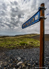 _DSC8268.JPG (bm.tully) Tags: road travel portrait sky mountain mountains nature grass sign clouds contrast point is iceland spring rust rocks colorful afternoon outdoor sony south himmel wideangle roadtrip directions deserted ringroad 2016 a7ii sonya7ii