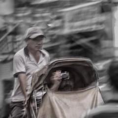 The adventurous life of tourists in Saigon (TikoTak) Tags: street camera tourism sepia asia taxi south tourist passengers east vietnam adventure asie rickshaw rue saigon passager tourisme touriste scne
