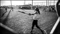 Warm-Up in Hot Sun (alhawley) Tags: girls blackandwhite bw usa monochrome backlight athletic baseball photojournalism american americana softball athlete ricoh photoessay ricohgrii everytownusa