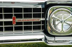 Olds egg crate (GmanViz) Tags: color detail car automobile 1966 98 bumper chrome badge headlight grille oldsmobile gmanviz