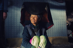 Grace in her eyes and a pentagon on her head~ Yi village ~ Yunnan (~mimo~) Tags: china old portrait woman mountain lady photography asia tibet shangrila tibetan yunnan minority yi ethnicminority mimokhairphotography