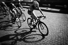 Triathlon.. (Peter Levi) Tags: street blackandwhite bw blancoynegro sports bike bicycle sweden stockholm 28mm streetphotography documentary cobblestones v gr triathlon ricohgr socialdocumentary grv apsc pentaxricoh pentaxricohimaginggr worldchampionshiptriathlonstockholm