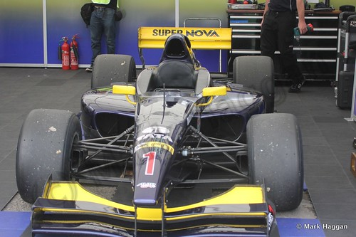 The Auto GP car of Narain Karthikeyan in its garage at Donington Park
