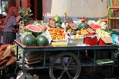 Street fruits stall in Urumqi ウルムチ、露店の果物屋 (travelingmipo) Tags: street travel people fruits photo market uighur xinjiang silkroad 新疆 uyghur bazaar 旅行 シルクロード urumqi 市場 乌鲁木齐 写真 ウルムチ 维吾尔 ئۇيغۇر ウイグル バザール 自治区