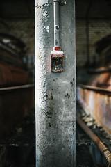 Props (Geoff ☆ RT Ficiel ☆) Tags: orange usa abandoned alarm start screw concrete fire nikon rust colorado industrial decay pipe pole chain stop button dust press scratch props sugarmill 35mmf2afd d700