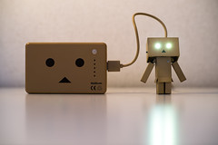 Recharging Danbo Power (Takashi(aes256)) Tags: light reflection eye mobile phone flash battery smartphone charge recharge   danbo       nikond4     nikonafsnikkor85mmf14g