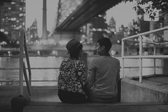 Sitting here, I don't care for you / Sitting there, you don't care for me / But I think we're in love. (Explored) (Linh H. Nguyen) Tags: bridge white black love monochrome night couple bokeh explore triste romantic takumar5014 nex7 lensturbo